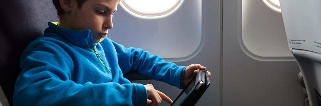 kid getting entertained on a flight