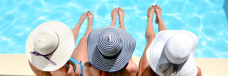 women sat by pool