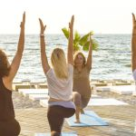 yoga on the beach - staying fit on holiday