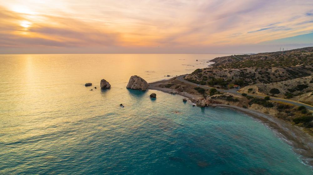 Aphrodites-rock-sunset-beach-paphos-cyrpus