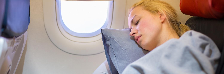 sleep on plane_395017804